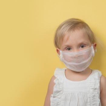 child wearing covid mask
